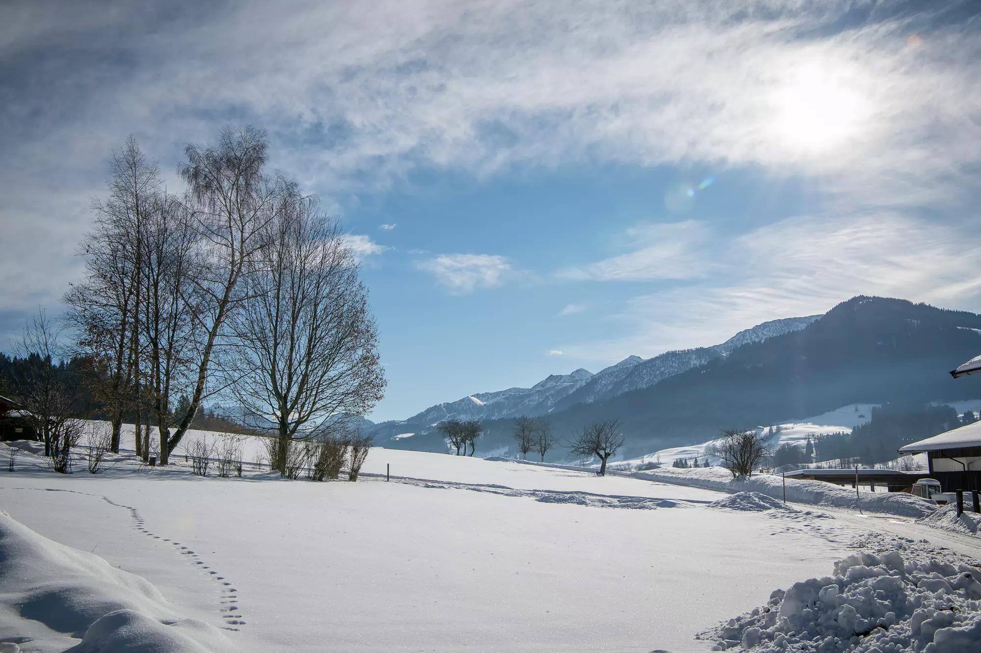 Immobilien - Grundstück mit einem Familienhaus in fantastischer Lage, St. Johann in Tirol